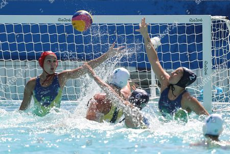 Stock Picture of Holly Lincoln-smith of Australia (c) Shoots on Goal As Goal Keeper Tess Oliveira of Brazil (l) Defends During the Women's Water Polo Game of the Rio 2016 Olympic Games at the Maria Lenk Aquatics Centre in the Olympic Park in Rio De Janeiro Brazil 13 August 2016 Brazil Rio De Janeiro