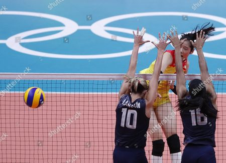 Ruoqi Hui (facing) of China in Action Against Jordan Larson-burbach (l) and Foluke Akinradewo (r) of the Usa During the Women's Preliminary Pool B Volleyball Match Between the Usa and China of the Rio 2016 Olympic Games at Maracanazinho Indoor Arena in Rio De Janeiro Brazil 14 August 2016 Brazil Rio De Janeiro