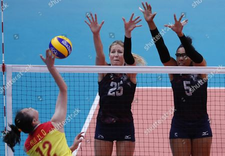 Ruoqi Hui (l) of China Spikes the Ball Against Karsta Lowe (c) and Rachael Adams (r) of the Usa During the Women's Preliminary Pool B Volleyball Match Between the Usa and China of the Rio 2016 Olympic Games at Maracanazinho Indoor Arena in Rio De Janeiro Brazil 14 August 2016 Brazil Rio De Janeiro