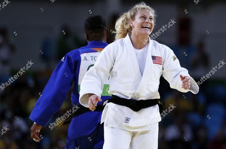 Kayla Harrison of Usa (white) Celebrates Winning Over Audrey Tcheumeo of France (blue) During the Women's -70kg Final Gold Medal Bout of the Rio 2016 Olympic Games Judo Events at the Carioca Arena 2 in the Olympic Park in Rio De Janeiro Brazil 11 August 2016 Brazil Rio De Janeiro