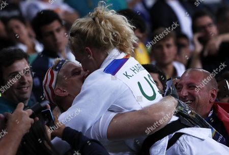 Kayla Harrison of Usa (white) Celebrates with a Spectator Winning Over Audrey Tcheumeo of France (blue) During the Women's -70kg Final Gold Medal Bout of the Rio 2016 Olympic Games Judo Events at the Carioca Arena 2 in the Olympic Park in Rio De Janeiro Brazil 11 August 2016 Brazil Rio De Janeiro