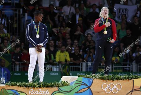 Gold Medalist Kayla Harrison of the Usa (r) and Silver Medalist Audrey Tcheumeo of France (l) on the Podium During the National Anthem After the Women's -78kg Bout of the Rio 2016 Olympic Games Judo Events at the Carioca Arena 2 in the Olympic Park in Rio De Janeiro Brazil 11 August 2016 Brazil Rio De Janeiro