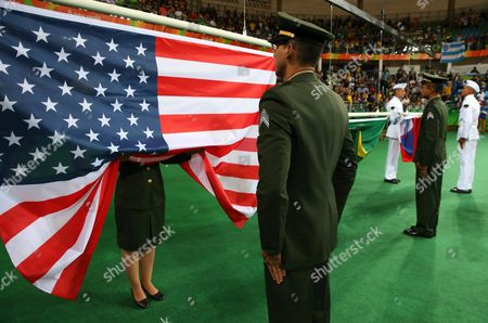 The United States of American Flag About to Be Raised For Gold Medalist Kayla Harrison of Usa During the Awards Ceremony in the Women's -78kg Bout of the Rio 2016 Olympic Games Judo Events at the Carioca Arena 2 in the Olympic Park in Rio De Janeiro Brazil 11 August 2016 Brazil Rio De Janeiro