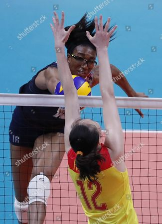 Foluke Akinradewo (l) of the Usa Spikes the Ball Against Ruoqi Hui of China During the Women's Preliminary Pool B Volleyball Match Between the Usa and China of the Rio 2016 Olympic Games at Maracanazinho Indoor Arena in Rio De Janeiro Brazil 14 August 2016 Brazil Rio De Janeiro