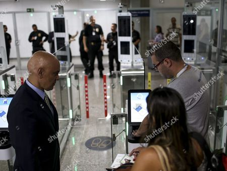 Brazilian Minister of Justice Alexandre De Moraes (l) Observes a Machine That Scans the Passport of Passengers As Hundreds of Members of the Military Police and the National Forces of Sao Paulo Arrive to Rio De Janeiro to Reinforce the Security During the Upcoming Olympic Games Rio 2016 in Rio De Janeiro Brazil 29 July 2016 the Rio 2016 Olympic Games Take Place From 05 to 21 August Brazil Rio De Janeiro