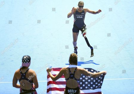 Stock Picture of Allysa Seely (front R) and Hailey Danisewicz (l) Both of the Usa Wait For Their Compatriot Melissa Stockwell (back) During the Women's Pt2 Triathlon Competition of the Rio 2016 Paralympic Games at Fort Copacabana in Rio De Janeiro Brazil 11 September 2016 Seely Won Ahead of Second Placed Danisewicz and Third Placed Stockwell Brazil Rio De Janeiro