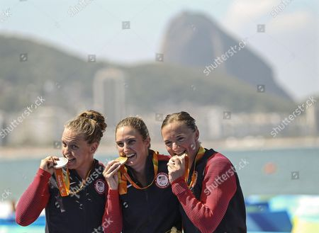 Stock Photo of Allysa Seely (c) of the Usa Poses with Her Gold Medal on the Podium After Winning the Women's Pt2 Triathlon Competition of the Rio 2016 Paralympic Games at Fort Copacabana in Rio De Janeiro Brazil 11 September 2016 Seely Won Ahead of Her Compatriots Second Placed Hailey Danisewicz (l) and Third Placed Melissa Stockwell (r) Brazil Rio De Janeiro