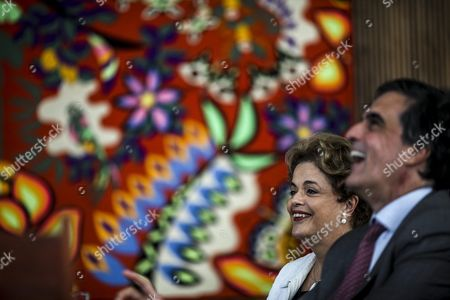 Suspended Brazilian President Dilma Rousseff (l) and Brazil's Attorney General Jose Eduardo Cardozo (r) Address a Press Conference at the Alvorada Palace in Brasilia Brazil 13 May 2016 Brazilian President Dilma Rousseff on 12 May 2016 was Suspended From Office in Order to Face an Impeachment Trial on Charges of Using Accounting Trickery in 2014 when She Won Re-election and 2015 to Disguise the Size of the Budget Deficit Rousseff Denies Any Wrongdoing and Says She is the Victim of a Coup if She is Permanently Ousted Temer Will Serve out the Rest of Her Term Which Currently is Due to Expire on 01 January 2019 Brazil Brasilia
