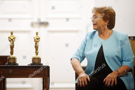 Stock Image of Chilean President Michelle Bachelet Speaks with Director of Punkrobot Production Company Gabriel Osorio (out of Frame) During a Meeting at La Moneda Palace in Santiago Chile 01 March 2016 Osorio and His Team of Punkrobot Winning the Academy Awards Oscar For the Animated Short 'Bear Story' Chile Santiago