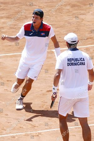 Jose Hernandez (l) and Manuel Castellanos of the Dominican Republic in Action Against Chilean Players Julio Peralta and Hans Podlipnik on the First Round of American Zone of David Cup in Santiago De Chile Chile 05 March 2016 Chile Santiago