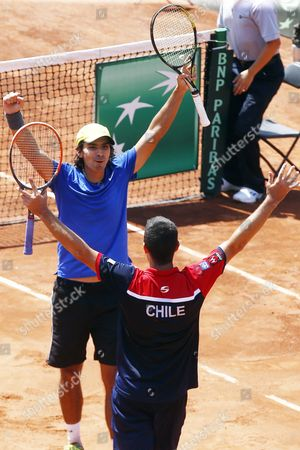 Chilean Players Julio Peralta (l) and Hans Podlipnik (r) Celebrate Their Victory Over Dominicans Jose Hernandez and Manuel Castellanos on the First Round of American Zone of David Cup in Santiago De Chile Chile 05 March 2016 Chile Santiago
