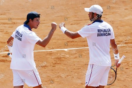 Jose Hernandez (l) and Manuel Castellanos (r) of the Dominican Republic React During Their Game Against Chileans Julio Peralta and Hans Podlipnik in the First Round of American Zone of David Cup in Santiago De Chile Chile 05 March 2016 Chile Santiago