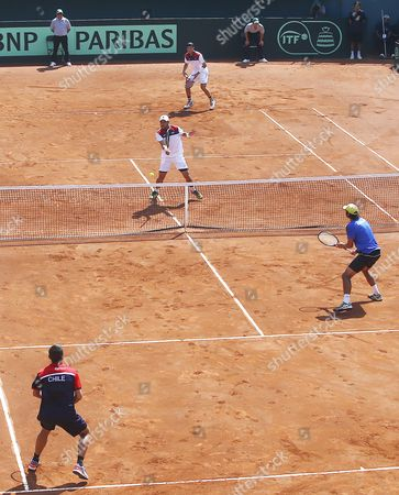 Chilean Players Julio Peralta (r) and Hans Podlipnik (l) in Action Against Jose Hernandez (2r and Manuel Castellanos (2l) of the Dominican Republic in the First Round of American Zone of David Cup in Santiago De Chile Chile 05 March 2016 Chile Santiago