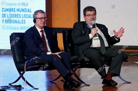 Bilbao's Mayor Juan Maria Aburto (r) Speaks Next to Brussels Mayor Yvan Mayeur (l) During the Sustainable Movility Forum Held During the Frameworks of the Fifth Regional and Local Mayors and Leaders in Bogota Colombia 14 October 2016 Colombia Bogota