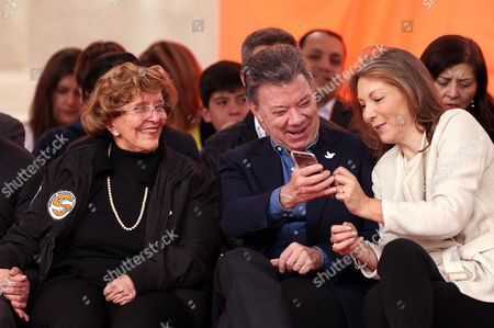 Colombian President Juan Manuel Santos (c) Accompanied by His Wife Maria Clemencia Rodriguez (r) and Director of Solidarity For Colombia Foundation Nidia Quintero De Belalcazar (l) During the Annual Event 'Walk of the Solidarity For Colombia' in Bogota Colombia 28 August 2016 Hours Before the Beginning of the Definitive Ceasefire Between Colombian Forces and the Farc Guerrilla Colombia Bogota