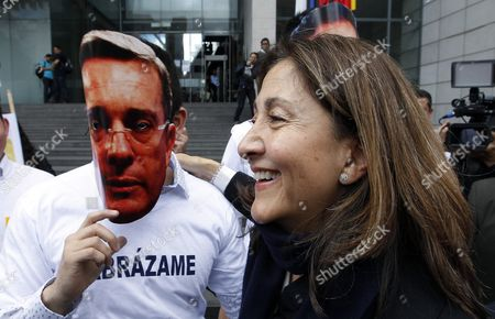 Colombian Former Presidential Candidate and Former Hostage by Revolutionary Armed Forces of Colombia Ingrid Betancourt (r) Passes a Man Wearing a Mask of Former Colombian President Alvaro Uribe After the Forum 'The Reconciliation More Than Magic Realism' in Bogota Colombia 05 May 2016 Betancourt who Returned to Colombia After Six Years Asked the Country to Defeat the 'Deshumanization' of the Internal Armed Conflict Colombia Bogota