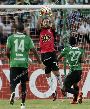 Huracan's Marcos Diaz (c) Grabs the Ball As Atletico Nacional's Luis Carlos Ruiz (r) and Victor Ibarbo (l) Look on During Their Copa Libertadores Soccer Game at Atanasio Girardot Stadium in Medellin Colombia 19 April 2016 Colombia Medellin