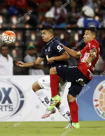 Luis Carlos Arias (r) of Independiente Medellin Vies For the Ball with Andres Lopez (l) of Universidad Catolica During the Copa Sudamericana Soccer Tournament Match Between Independiente Medellin and Universidad Catolica at the Atanasio Girardot Sports Complex in Medellin Colombia 10 August 2016 Colombia Medellin
