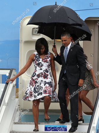 Us President Barack Obama (r) Carries an Umbrella As He and First Lady Michelle Obama (l) Disembark From 'Air Force One' After Their Arrival on Jose Marti Airport in Havana Cuba 20 March 2016 Barack Obama Arrives in Cuba For an Official Visit Until 22 March to Seal the Process of Rapprochement with the Communist-ruled Island Obama is Accompanied by His Wife Michelle His Daughters Malia and Sasha and His Mother-in-law Marian Robinson the Visit of Obama to Cuba From 20 to 22 March 2016 is the First Visit of a Us President to Cuba Since Us President Calvin Coolidge's Visit 88 Years Ago Cuba Havana