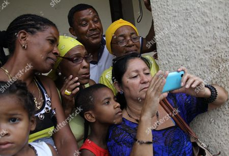 Cuban Citizens Look on a Mobile Phone at Abroadcast of the Us President Barack Obama's Arrival at the Jose Marti Airport in Havana Cuba 20 March 2016 Us President Barack Obama Arrives in Cuba For an Official Visit Until 22 March to Seal the Process of Rapprochement with the Communist-ruled Island Obama is Accompanied by His Wife Michelle His Daughters Malia and Sasha and His Mother-in-law Marian Robinson the Visit of Obama to Cuba From 20 to 22 March 2016 is the First Visit of a Us President to Cuba Since Us President Calvin Coolidge's Visit 88 Years Ago Cuba Havana