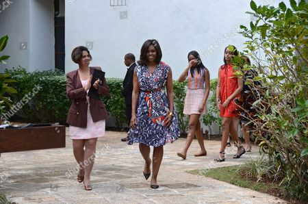 Us First Lady Michelle Obama (c) Walks Next to Director of Heritage of Historian Office of the City Lesbia Mendes Vargas (l) As She Arrives Accompanied by Her Daughters Malia (2r) and Sasha (3r) and Her Mother Marian Robinson (r) to a Ceremony at Public Library Ruben Martinez Villena in Havana Cuba 22 March 2016 the Family Obama Planted Two Trees and Donated a Bench For the Institution Us President Obama is on an Official Visit to Cuba From 20 to 22 March 2016 the First Sitting Us President to Visit Since Calvin Coolidge 88 Years Ago Cuba Havana
