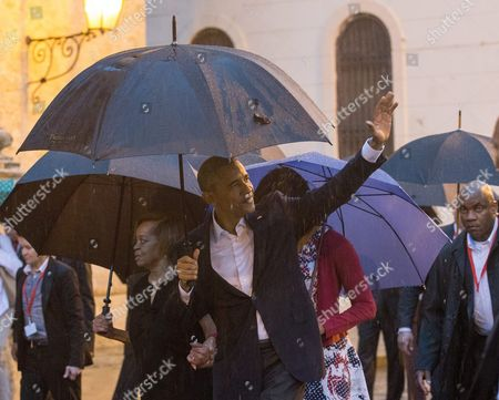 Us President Barack Obama (front) Waves Upon His Arrival to the Cathedral Havana Cuba 20 March 2016 Us President Barack Obama Arrives in Cuba For an Official Visit Until 22 March to Seal the Process of Rapprochement with the Communist-ruled Island Obama is Accompanied by His Wife Michelle His Daughters Malia and Sasha and His Mother-in-law Marian Robinson the Visit of Obama to Cuba From 20 to 22 March 2016 is the First Visit of a Us President to Cuba Since Us President Calvin Coolidge's Visit 88 Years Ago Cuba Havana