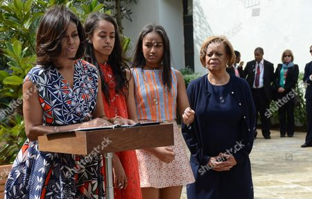 Us First Lady Michelle Obama (l) Speaks Accompanied by Her Daughters Malia (2l) and Sasha (2r) and Her Mother Marian Robinson (r) During a Ceremony at Public Library Ruben Martinez Villena in Havana Cuba 22 March 2016 the Family Obama Planted Two Trees and Donated a Bench For the Institution Us President Obama is on an Official Visit to Cuba From 20 to 22 March 2016 the First Sitting Us President to Visit Since Calvin Coolidge 88 Years Ago Cuba Havana