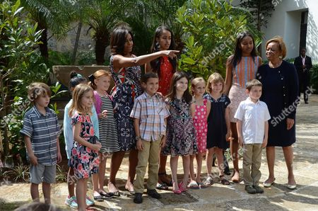 Us First Lady Michelle Obama (l) Speaks Accompanied by Her Daughters Malia (2l) and Sasha (2r) and Her Mother Marian Robinson (r) Pose with a Group of Kids During a Ceremony at Public Library Ruben Martinez Villena in Havana Cuba 22 March 2016 the Family Obama Planted Two Trees and Donated a Bench For the Institution Us President Obama is on an Official Visit to Cuba From 20 to 22 March 2016 the First Sitting Us President to Visit Since Calvin Coolidge 88 Years Ago Cuba Havana