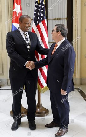 Cuban Foreign Affairs Minister Bruno Rodriguez (r) Receives Us Transport Secretary Anthony Foxx (l) at His Arrival to the Ministery in Havana Cuba on 31 August 2016 Foxx Arrived in Cuba on Jetblue Flight 387 the First Commercial Flight Between Usa and Cuba Since 1961 Which Landed in Santa Clara on 31 August After a Trade Embargo Prohibited Tourist Air Service Between the Two Countries For Over Fives Decades Cuba Havana