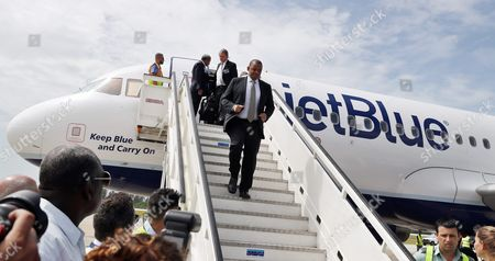 Us Transport Secretary Anthony Foxx (c) Arrives to Cuba on a Plane of Us Airline Jetblue That Started in Fort Lauderdale Usa at the Abel Santamaria Airport in the City of Santa Clara Cuba 31 August 2016 Jetblue Flight 387 the First Commercial Flight Between Usa and Cuba Since 1961 Landed in Santa Clara on 31 August After a Trade Embargo Prohibited Tourist Air Service Between the Two Countries For Over Fives Decades Cuba Santa Clara