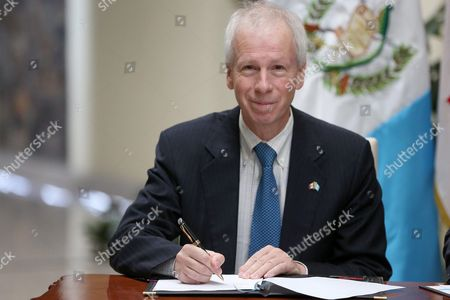 Canadian Foreign Minister Stephane Dion Signs a Document As He Meets Guatemala's Foreign Minister Morales (not Pictured) in Guatemala City Guatemala 13 October 2016 Both Ministers Signed an Agreement to Maintain the Relationship of Bilateral Cooperation Established 50 Years Ago Between the Two Nations Dion Performs a Three-day Visit to Mexico Guatemala and Honduras with the Purpose of Strengthening Diplomatic Ties Guatemala Guatemala City