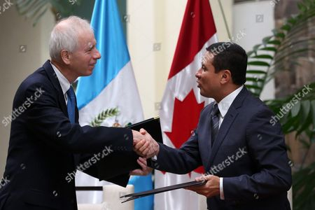 Canadian Foreign Minister Stephane Dion (l) and Guatemala's Foreign Minister Carlos Raul Morales (r) Erxchange Documents in Guatemala City Guatemala 13 October 2016 Both Ministers Signed an Agreement to Maintain the Relationship of Bilateral Cooperation Established 50 Years Ago Between the Two Nations Dion Performs a Three-day Visit to Mexico Guatemala and Honduras with the Purpose of Strengthening Diplomatic Ties Epa/esteban Biba Guatemala Guatemala City
