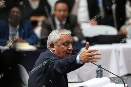 Stock Picture of Former Guatemalan President Otto Perez Molina Accused of Leading a Customs Corruption Network Between 2012 and 2015 Protests and Denies the Accusations of International Commissioner Against Corruption in Guatemala Colombian Ivan Velazquez and the Collaborator of the Attorney's Office Juan Carlos Monzon During a Hearing in Guatemala City Guatemala 27 June 2016 Guatemala Guatemala City