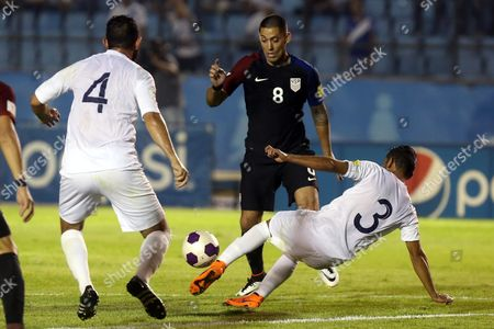 Guatemala Cristian Jimenez (r) and Hamilton Lopez (l) Against Usa's Clint Dempsey (c) During the Fifa World Cup 2018 Qualification Match Between Guatemala and Usa at Mateo Flores Stadium in Guatemala City Guatemala 25 March 2016 Guatemala Guatemala City