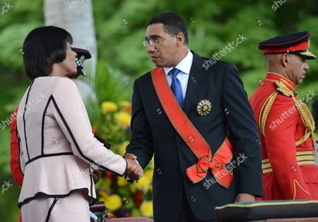 Jamaica Labor Party (jlp) Leader Andrew Holness (c) Shakes Hand with Former Prime Minister Portia Simpson-miller (l) During His Sworn-in Ceremony in Kingston Jamaica 03 March 2016 the Jlp Leader Succeed Portia Simpson-miller Leader of the Now-main Opposition People's National Party Jamaica Kingston
