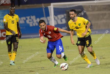 Jamaica's Je-vaughn Watson (l) and Joel Mcanuff (r) Against Costa Rica's Randall Azofeifa (c) During the Fifa World Cup Qualifying Match Between Jamaica and Costa Rica in Kingston Jamaica 25 March 2016 Jamaica Kingston