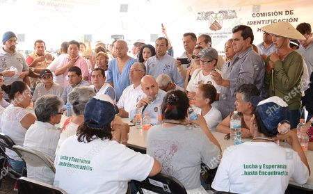 Prosecutor of Morelos Javier Perez Duron (c) Speaks to Relatives of Missing Persons About the Exhumation of Over 100 Bodies at the Tetelcingo Pit in Morelos Mexico 23 May 2016 the Procedure is Led by Morelos State General Attorney's Office and Carried out by the Attorney's General Office and the National Commission of Security at Least 25 Families From the Area Have Missing Relatives But the Bodies Are Yet to Be Identified Mexico Tetelcingo