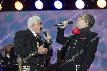 Mexican Singer Vicente Fernandez (l) and His Son Alejandro Fernandez (r) Perform on Stage During Vicente Fernandez' Goodbye Concert at the Azteca Stadium in Mexico City Mexico 16 April 2016 Fernandez One of the Great Voices of the Ranchero Style Said Farewell to the Stage and His Fans with a Massive Free Concert Which was Presented Under the Title 'An Aztec in the Azteca' Mexico Mexico City