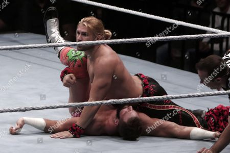 Stock Photo of Us Wrestler Zack Ryder (bottom) is Pinned by Us Wrestler Tyler Breeze (top) During the Wwe Live Tour Mexico in the Acropolis in Puebla Mexico 27 August 2016 Mexico Puebla