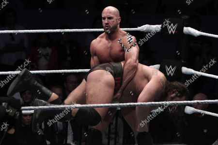 Stock Photo of Us Wrestler Cesaro (top) Performs a Move on Bulgarian Wrestler Alexander Rusev (bottom) During the Wwe Live Tour Mexico in the Acropolis in Puebla Mexico 27 August 2016 Mexico Puebla