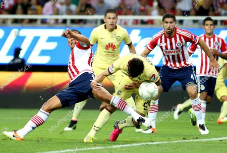 Chivas De Guadalajara's Oribe Peralta (r Front) Vies For the Ball Against Club America's Carlos Salcido (l Front) During the Quarter-final Match of Clausura Tournament of Mexican Soccer at the Chivas Stadium in Guadalajara Mexico 12 May 2016 Mexico Guadalajara