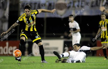 Olimpia Player Wilson Pittoni (r) Fights For the Ball with Deportivo Tachira's Daniel Febles (l) During a Libertadores Cup Match Held at Manuel Ferreira Stadium in Asuncion Paraguay 13 April 2016 Paraguay Asunci?n