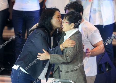 Stock Image of Peruvian Presidential Candidate For the Fuerza Popular (popular Force) Party Keiko Fujimori (l) Kisses Her Mother Susana Higuchi (r) During a Campaign Event in Lima Peru 02 June 2016 Peru Will Hold the Second Round of Presidential Elections on 05 June 2016 with Peruvians For Change Party Nominee Pedro Pablo Kuczynski and Keiko Fujimori As Candidates Peru Lima