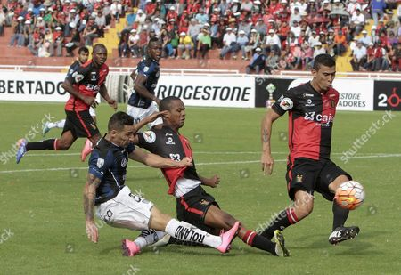 Independiente Del Valle?s Christian Nunez (l) Against Melgar?s Nilson Loyola (c) and Juan Bolanos (r) During a Libertadores Cup Soccer Match in Arequipa Peru 01 March 2016 Peru Arequipa