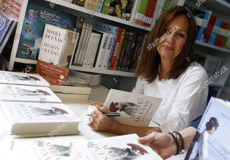 Spanish Writer Maria Duenas Signs Copies of Her Book 'La Templanza' (temperance) at a Stand in the 75th Madrid Book Fair Spain 29 May 2016 France is the Guest Country This Year and the Fair is Focused on Spanish Writer Miguel De Cervantes Marking the 400th Anniversary of His Death the Fair Runs Until 12 June Spain Madrid