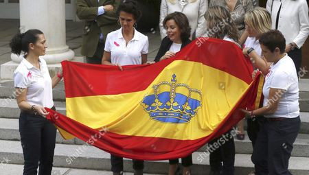 Stock Photo of Spanish Acting Vice Prime Minister Soraya Saez De Santamaria (c) Gives the Spanish National Flag to the Members of the Pelayo Life Challenge Yolanda Preciados Susana Laguarda Marian Santiago Carmen Pelaez and Patricia Alonso in Madrid Spain 20 October 2016 the Five Women Will Travel Around the Atlantic Ocean During Two Weeks to Prove That There is Life After Breast Cancer Spain Madrid