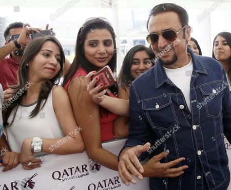 Indian Actor Gulshan Grover (r) Poses For a Selfie with Fans As He Arrives at the Adolfo Suarez Madrid-barajas Airport in Madrid Spain 22 June 2016 the International Indian Film Academy Awards Will Be Held in Madrid on 25 June Spain Madrid