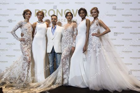 Pronovias' Creative Director French Herve Moreau (3-l) Poses with Models Irina Shayk (3-r) Romee Strijd (2-l) Jae Jagaciak (l) Cindy Bruna (2-r) and Kate Grigorieva (r) Before the Pronovias' Parade on the Occassion of the Barcelona Bridal Fashion Week Held in Barcelona Spain 29 April 2016 the Event Runs From 26 to 29 April Spain Barcelona