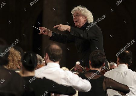 Bristish Conductor Sir Simon Rattle (up) and the London Symphony Orchestra Perform on Stage During the Granada?s Dance and Music International Festival Concert Held at the Carlos V Palace in Granada Southern Spain 02 July 2016 Spain Granada