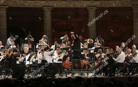 Bristish Conductor Sir Simon Rattle (c) and the London Symphony Orchestra Perform on Stage During the Granada?s Dance and Music International Festival Concert Held at the Carlos V Palace in Granada Southern Spain 02 July 2016 Spain Granada